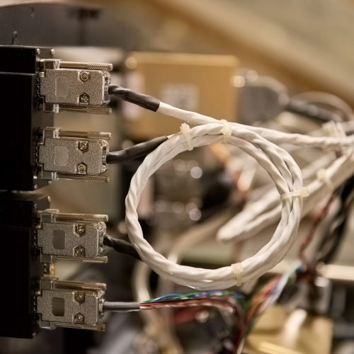 Wires of airplane dashboard. Cables with plugs close up. What is avionics.